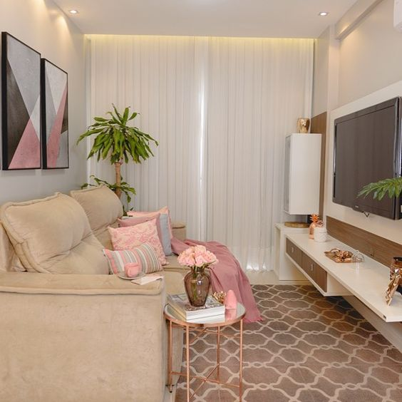 living room, pink rug, white wall, brown sofa, white floating table, TV, copper side table