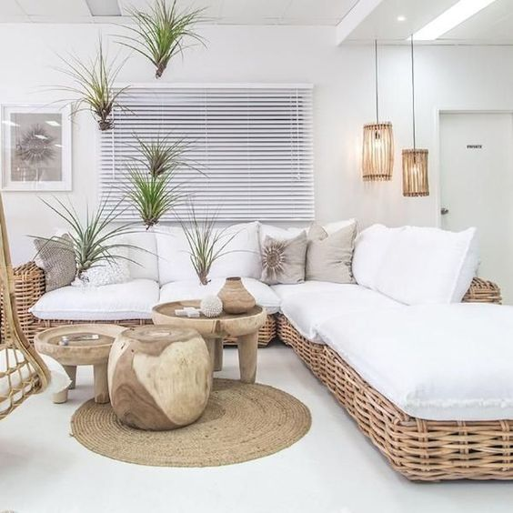 living room, white floor, white wall, rattan sofa, white cushion, wooden coffee tables, rattan rug