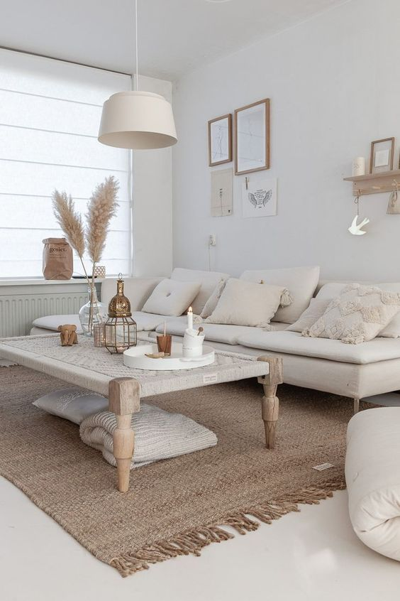 living room, white floor, white wall, white flat sofa, wooden rattan coffee table, white pendant