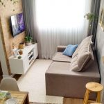 Living Room, Wooden Floor, Pink Square Sofa, Grey Wall, Partition With Open Wall Look, White Rug, White Floating Cabinet, TV