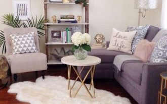 living room, wooden floor, purple corner sofa, white coffee table, shelves, pink chair, side table