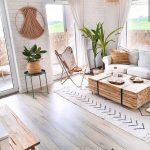 Living Room, Wooden Floor, White Open Wall, White Sofa, Wooden Chest, Butterfly Chair, Rug, Rattan Pendants, White Curtain, Plants