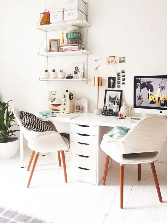 minimalist study with whtie table, drawers, white modern chairs, white floating shelves, white wall, white floor