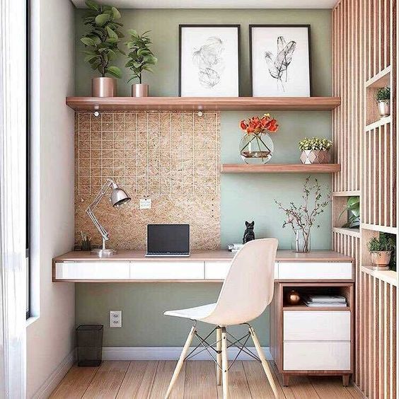 minimalist study, wooden floor, green accent wall, wooden partition, floating desk top, drawer, wooden wire, floating shelves