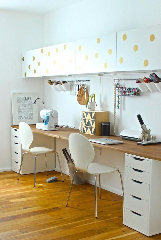 minimalist study, wooden floor, white wall, white drawers, white chair, whtie floating shelves with golden dots, wooden top, silver rod