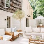 Patio, White Floor, White Exposed Brick Wall, White Sofa, Wooden Chairs, White Cushion, Bamboo Coffee Table With Glass Top