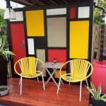 Patio, Wooden Platform, Yellow Chairs, Wooden Table, Yellow Red Blocks Of Background