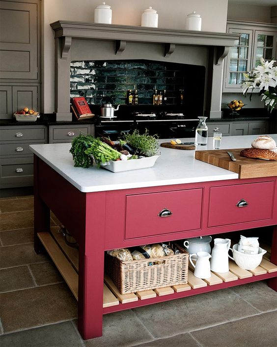 pink island, grey floor, grey wall, grey cabinet, grey floating shelves, pink wooden traditional island, white top
