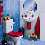 Toilet, Blue Wall And Floor Tiles, White Wall Tiles, White Sink, White Toilet Red Lid, Round Mirror