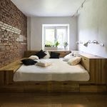 Wooden Bed Platform, Wooden Floor, White Wall, Exposed Accent Wall, Sconces