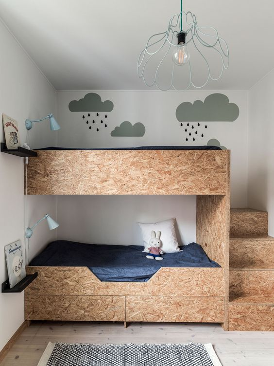 wooden bunkbed, stairs at the side, bottom drawers white wall, white ceiling, metal pendant