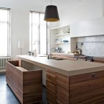 Wooden Island, Black Floor, White Wall, White Backsplash Tiles, Wooden Cabinet, Brown Top, Wooden Bench