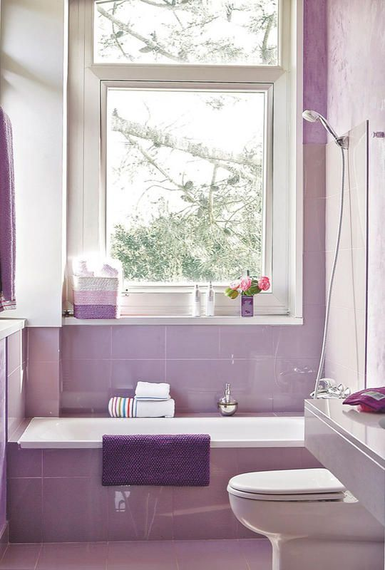 bathrom, purle wall, purple floor, purple tub with white inside, white toilet, white wall