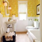 Bathroom, Beige Floor Tiles, White Wainscoting, Yellow Wallpaper, White Tub, White Toilet, White Sink, White Framed Mirror