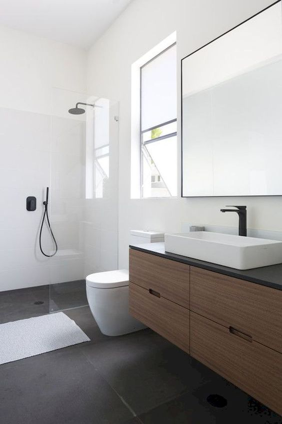 bathroom, black floo, white seamless wall, wooden floating vanity, black top, white sink, large square mirror, large glass window, white toilet