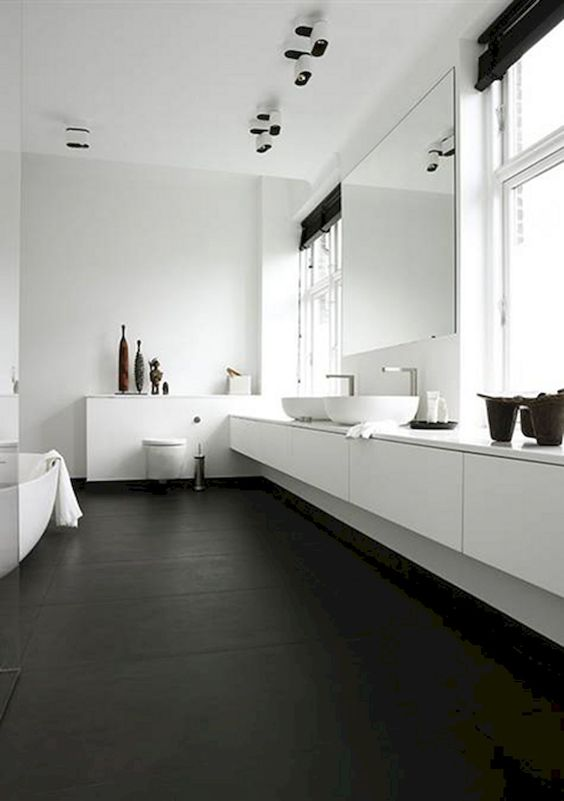 bathroom, black floor, white floaing vanity, white top, white wall, white tub, white toilet, large mirror, glass window