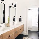 Bathroom, Black Floor, White Wall, Floating Wooden Vanity, White Top, Black Sconces, Rug,