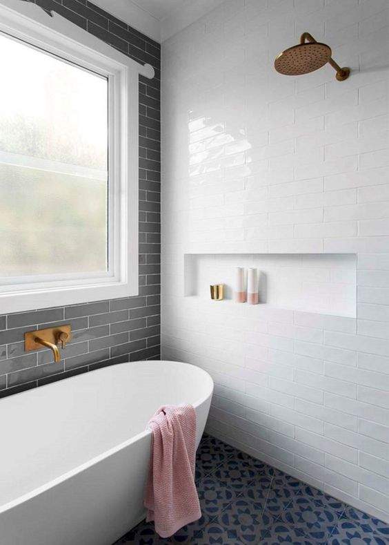bathroom, black patterned floor tiles, white subway wall tiles, black subway wall tiles, large glass window, gold shower, white tub