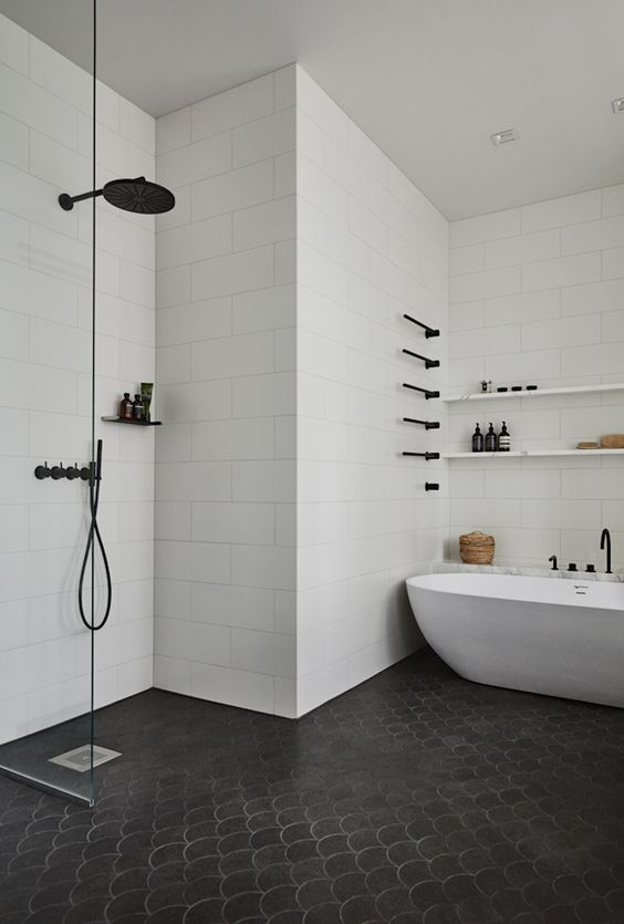 bathroom, black scale floor tiles, white subway wall tiles, white tub, white floating shelves
