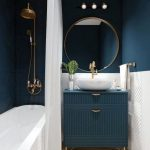 Bathroom, Dark Blue Wall, White Detailed Wall, Blue Cabinet, White Sink, White Tub, White Curtain