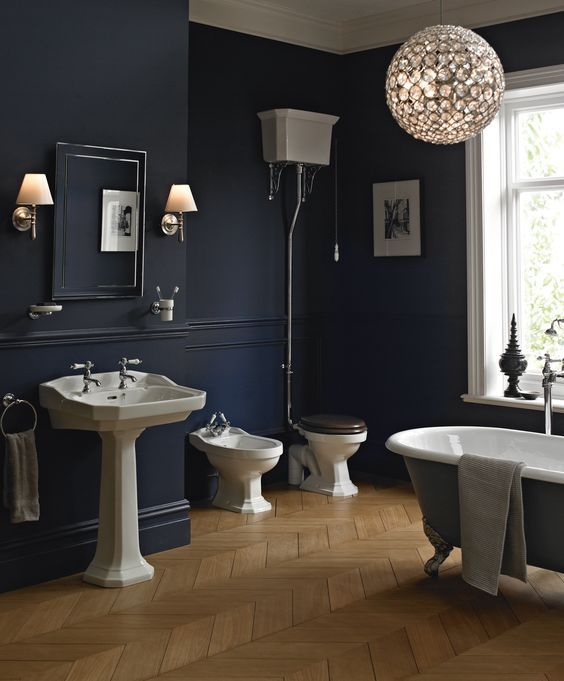 bathroom, dark blue wall, wooden floor, whtie toilet, white sink, grey tub, mirror