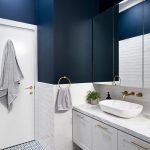 Bathroom, Dark Blur Wall, White Bottom Half, Blue Patterned Floor, White Floating Vanity Cabinet, Large Mirror