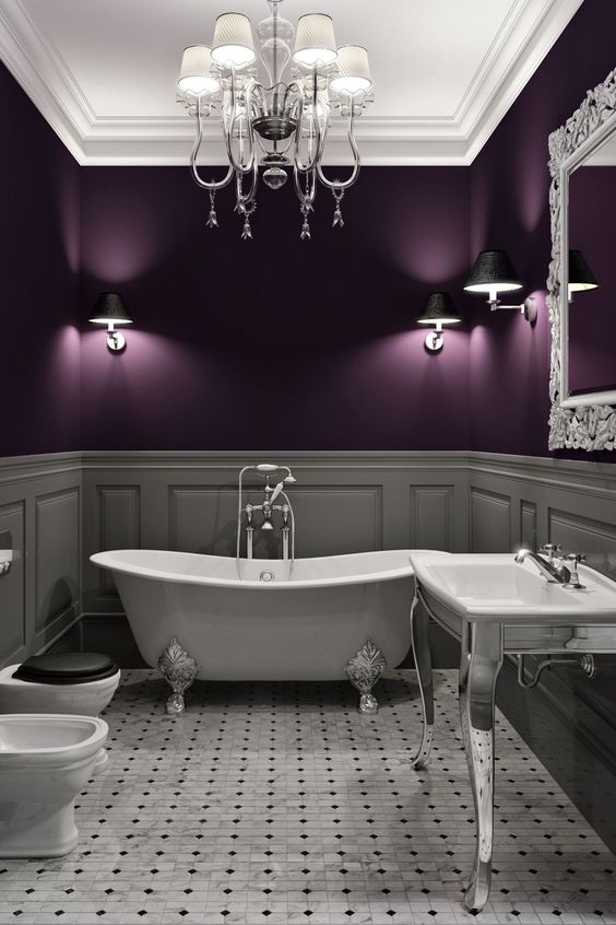 bathroom, grey floor tiles, grey wainscoting, purple wall, white ceiling, white chandelier, white tub, white toilet, white silver sink