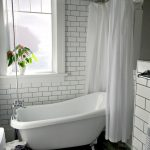 Bathroom, Patterned Floor, White Subway Wall Tiles, White Tub Curtain, White Tub, White Framed Window, White Toilet
