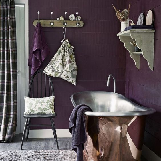 bathroom, purple wall plank, silver tub, floating shelves, wooden floor, rug