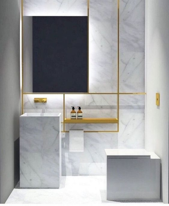 bathroom, white marble wall, golden lines shelves, mirror, white marble sink