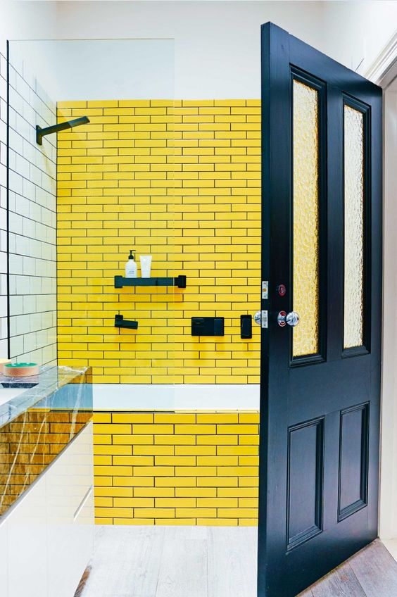 bathroom, white subway wall tiles, yellow subway wall tiles, white tub, wooden floor tiles, black door