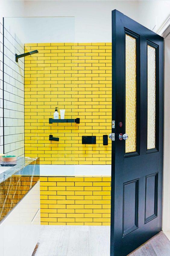 bathroom, white subway wall tiles, yellow subway wall tiles, white tub, wooden floor tiles, black door