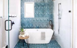 bathroom, white wall, white ceiling, blue patterned accent wall, floor, and ceiling, white tub, wooden stool