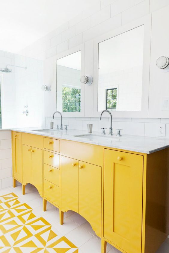 bathroom, white wooden floor, yellow pattern, yellow counter with white top, white subway wall tiles, mirrors