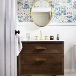 Bathroom, Wooden Floor, White Wainscoting, Flower Pattern Wallpaper, Glass Sconces, Wooden Vanity, Golden Framed Mirror