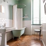 Bathroom, Wooden Herringbone Floor Tiles, White Wall Tiles, Green Wall, Green Tub, White Sink