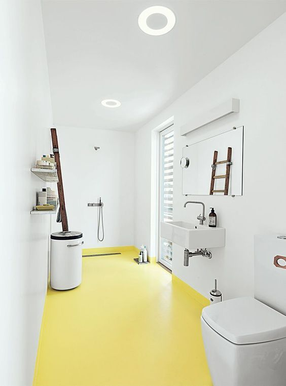 bathroom, yellow seamless floor, white wall, white floating sink, white toilet, white bin, wooden rack, mirror