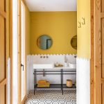 Bathroom, Yellow Wall, White Bottom Wall, Vanity Table White Counter Top, Patterned Floor Tiles