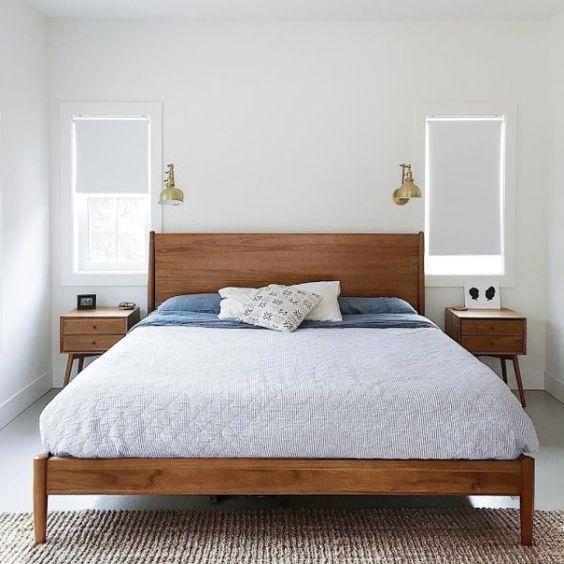 bedroom, seamless floor, carpet, wooden bed platform, blue bed, white wall, sconces, wooden side tables