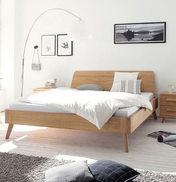 bedroom, white wooden floor, white wall, white floor lamp, wooden bed platfom, wooden side table, grey rug, white bedding
