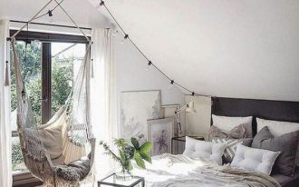 bedroom, wooden floor, white ceiling, white wall, black bed platform, white hammock