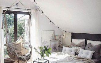 bedroom, wooden floor, white ceiling, white wall, black bed platform, white hammock