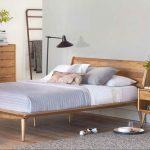 Bedroom, Wooden Floor, White Wall, Wooden Bed Platform, Black Floor Lamp, Wooden Cabinet, Grey Rug, Rack