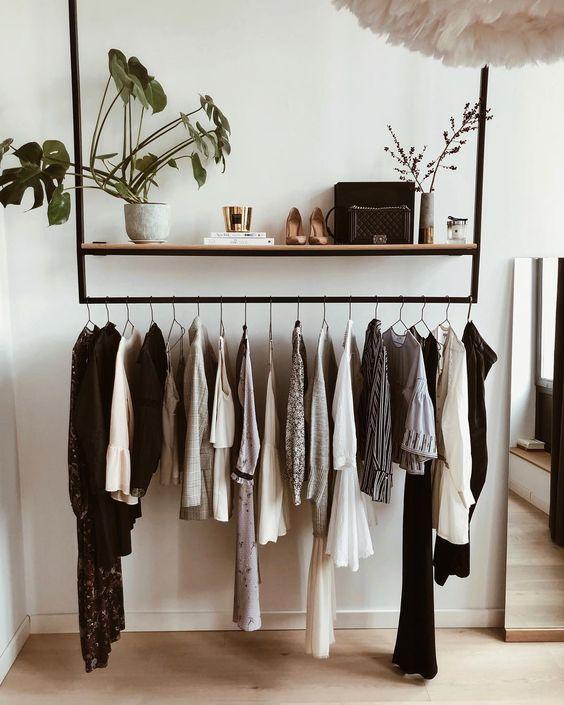 black metal rack mounted on ceiling, white wall, wooden floor,