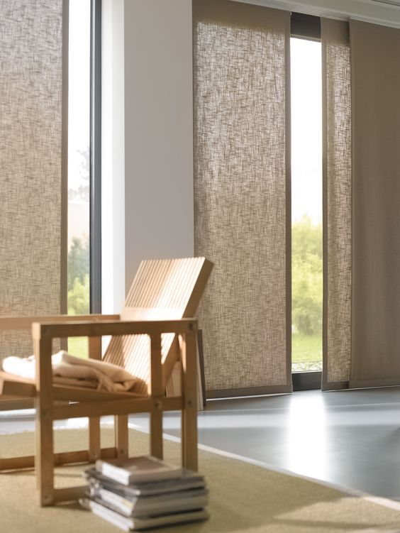 brown shade curtain, grey wall, grey seamless floor, brown rug, brown wooden chair