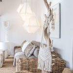 Brown Woven Rattan Sofa With Grey Cushion, Brown Rug, White Lantern Pendant, Wooden Coffee Table