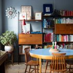 Dining Room, Round Wooden Table With Blue Top, Wooden Chairs, Wooden Floor, Grey Wall, Black Pendant, Wooden Shelves