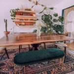 Dining Room, Wooden Floor, Rug, Wooden Table, Wooden Chairs, Metal Bench Green Velvety Bench, Floating Shelves, Golden Pendant
