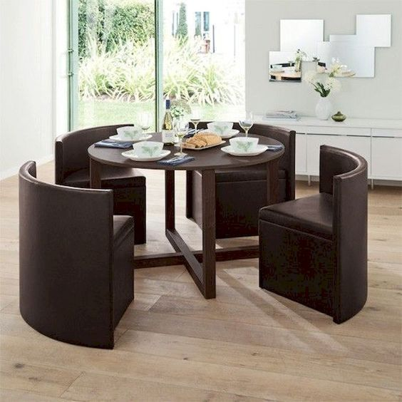 dining set, wooden floor, black round table, black leather chairs shaped inside