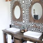 Farmhouse Vanity, Patterned Accent Wall, Golden Sconces, Wooden Framed Mirrors, Dark Wooden Vanity Table, White Sink